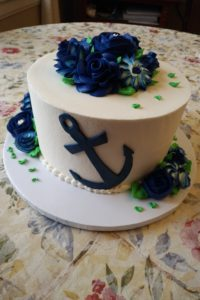 great lakes navy wedding cake theme. the groom is a recent graduate.